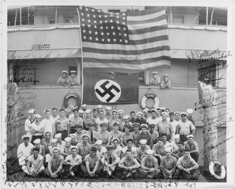 USS OMAHA/ODENWALD Incident during World War II. Autographed Portrait of Salvage Detail. American Flag and emblem of the Nazi party/ Swastika flag on ship with Salvage Detail portrait signed by each member of Salvage Detail.NH 123757