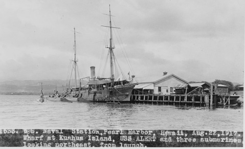 "USS Alert (Submarine Tender #4), serving as tender for the Third Submarine Division of the Pacific Fleet, laying alongside the wharf at Kuahua, U.S. Naval Station, Pearl Harbor, 22 August 1917. K-3 (Submarine #34) and K-4 (Submarine #35) are identifiable alongside; the unidentifiable ""boat"" is probably either K-7 (Submarine #38) or K-8 (Submarine #39).Official U.S. Navy Photograph, from the collections of the Naval History and Heritage Command. Catalog #: NH 42542"