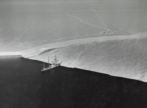 USS BEAR (AG-29) Awaiting to evacuate west base in the Bay of Whales, Antarctica in 1941, she noses against bay ice. Supplies had to be carried from the base camp in the background. Ross Barrier is the thick ice on the left. Description: Catalog #: NH 56697 Copyright Owner: Naval History and Heritage Command