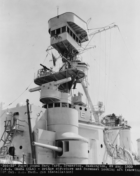 "Two of the 6""/53 casemate guns on USS Omaha CL-4 Picture taken in August 1933 after overhaul at the Puget Sound Navy Yard. Note newly installed machine gun bathtub atop Omaha foremast, rangefinders, and other fire control facilities on and about the mast, voice tubes running down from the masthead, and Battle Efficiency E painted on the pilothouse. Courtesy of Don S. Montgomery, USN (Retired). U.S. Naval History and Heritage Command Photograph. Catalog #: NH 93507"
