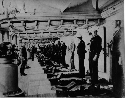 A footlocker inspection on the main deck in 1904. The Sailor on the left, closest to the camera, is Chester Bryon Harper. Courtesy of Mr. Gene B. Reid (Harper's grandson), 1983. U.S. Naval History and Heritage Command Photograph. Catalog #: NH 94193