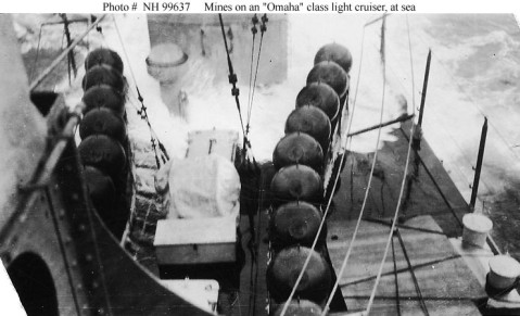 Mines on an Omaha class (CL 4-13) light cruiser Description: Taken while the ship was underway at sea, looking aft, showing the very wet conditions that were typical on these cruisers' after decks when they were operating in a seaway. Photographed circa 1923-1925, prior to the addition of a deckhouse just forward of the ships' after twin six-inch gun mount. Donation of Ronald W. Compton, from the collection of his grandfather, Chief Machinist's Mate William C. Carlson, USN. U.S. Naval History and Heritage Command Photograph. Catalog #: NH 99637