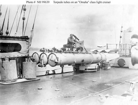 Triple 21-inch torpedo tubes on the upper deck of an Omaha (CL 4-13) class light cruiser, circa the mid-1920s. The after end of the ship's starboard catapult is visible at left. Donation of Ronald W. Compton, from the collection of his grandfather, Chief Machinist's Mate William C. Carlson, USN. U.S. Naval History and Heritage Command Photograph. Catalog #: NH 99639