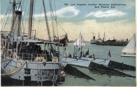 "Post card image of USS Alert (Submarine Tender #4) moored at San Pedro, CA. The submarines alongside are ""F"" class boats, circa 1916. Note the wicker deck furniture over her extensive awnings. http://www.navsource.org/archives/09/36/3604.htm Via Navsource: Photo - Ron Reeves Caption - Ric Hedman"
