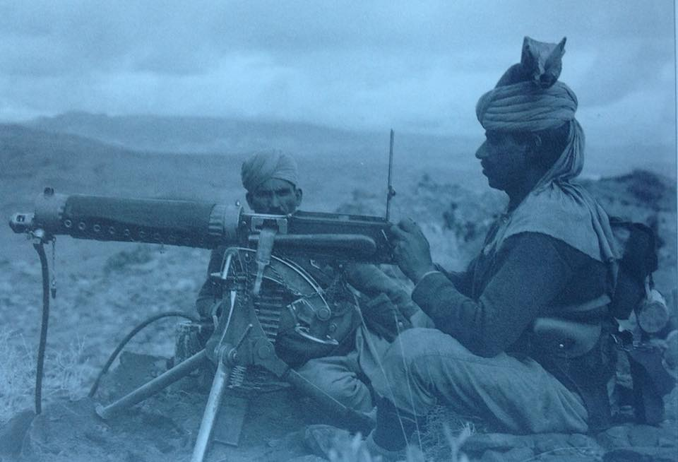 Sepoys manning a Vickers Machine Gun, Spinwam, south west of Peshawar. The sepoy manning the gun has a .455 Webley in a holster on his belt and a tin mug fastened to the 08 haversack on his back.