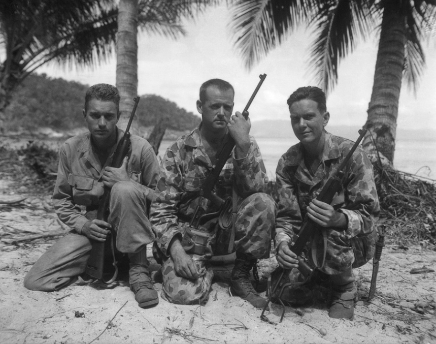 U.S. Army Alamo Scouts, two in HBT uniforms. William E. Nellist (middle) pictured with unidentified trainees from the 4th Class. Cape Kassoe, Hollandia, DNG. August 1944. Via Alamo Scouts website. http://www.alamoscouts.com/photo_archives/420_439.htm