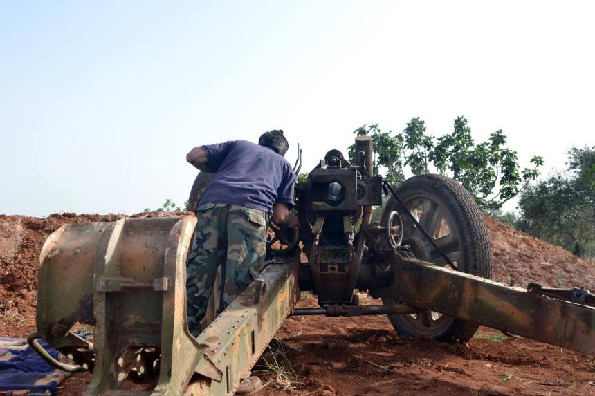 10.5 cm leFH 18M howitzer in action with Syrian rebels, over 70 years after it was manufactured and used by German troops during the Second World War
