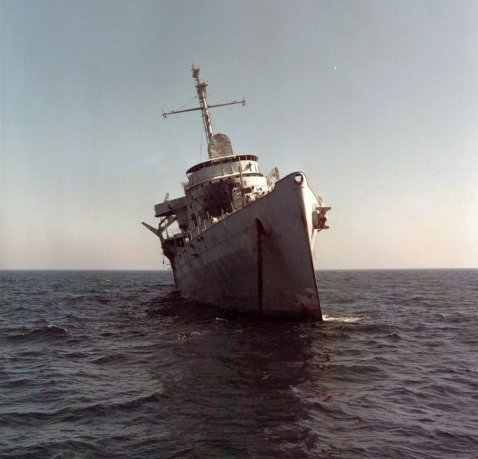 This photo shows Ozark listing at 16 degrees to starboard 12 hours before she sank. Wikemedia Commons, Gordon Starr, photographer,