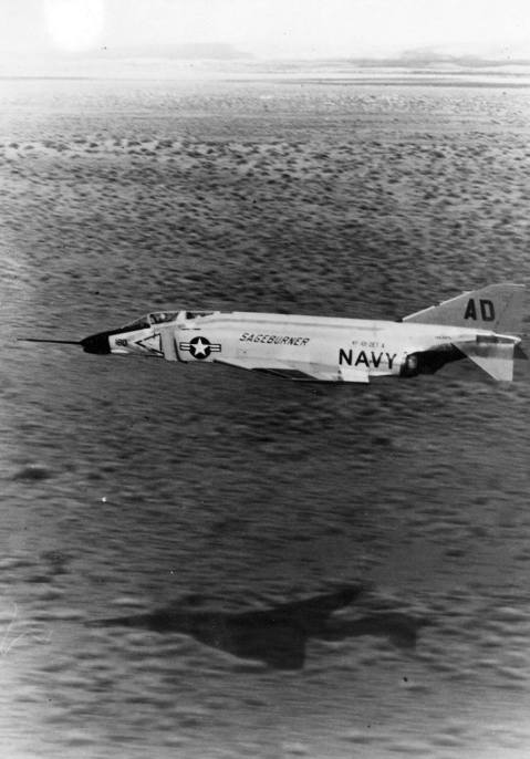 F4H-1 Phantom II crewed by pilot LT Hunt Hardisty and radar intercept officer LT Earl H. DeEsch sageburner in operation