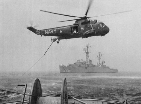 An RH-3A mine busting Sea King at play. Note the sweep gear. Catskill and Ozark could carry two of these aircraft while the other former LSDs converted to MCS configuration could carry as many as four