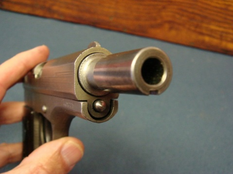 As you can see, the muzzle is slatted at the bottom with a notch