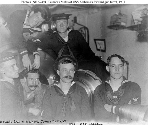 "Forward turret crew Gunner's Mates pose by the breech of one of the ship's 13""/35 guns, 1903. Note the ex-Apprentice marks (figure ""8"" knot badges) worn by two of these men.Photo # NH 57494, from the collections of the United States Naval Historical Center."