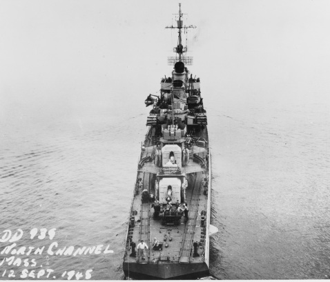 Aerial, aft of USS Z-39 (DD-939), note the mine rails over her stern. Off Boston, Massachusetts, 12 September 1945. Catalog #: 19-N-90598