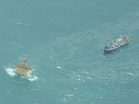 The FV Naham 3, right, tied to the sunken cargo ship MV Albedo, the latter pirated in November 2010. Photo: EU NAVFOR
