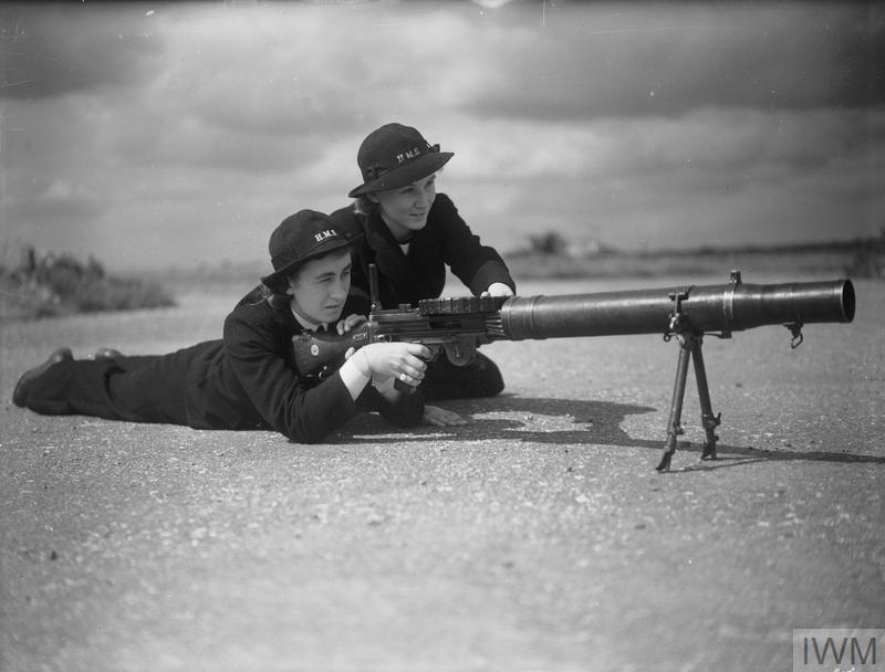 WOMEN ON THE HOME FRONT 1939 - 1945 (A 13209) The Women's Royal Naval Service (WRNS): Wren Armourers, whose jobs included the overhaul, maintenance and serving of guns, pictured testing a Lewis gun at Lee-on-Solent Naval Air Station. Copyright: © IWM. Original Source: http://www.iwm.org.uk/collections/item/object/205193235