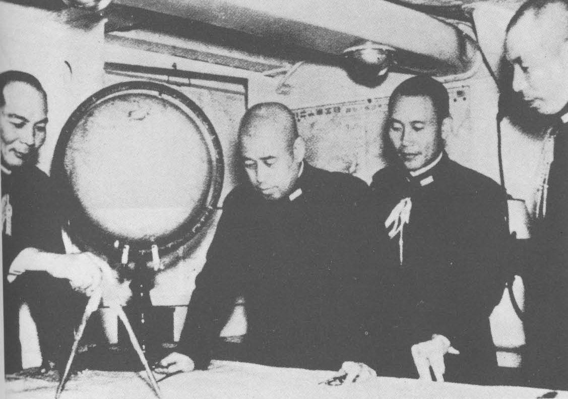 Chief of Staff Matome Ugaki (left), Admiral Isoroku Yamamoto, liaison staff officer Shigero Fujii, and administrative officer Yasuji Watanabe aboard battleship Nagato, early 1940s