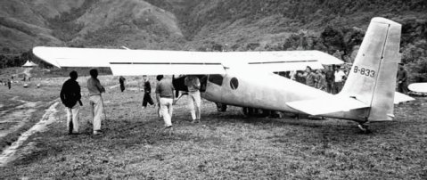 Helio-Courier on the ground in Laos. The aircraft was better suited to mountain flying than helicopters, but it was demanding to fly. CIA file photo