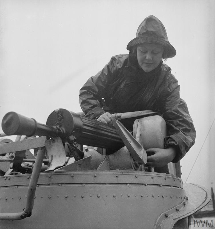 WOMEN'S ROYAL NAVAL SERVICE. MAINTENANCE WRENS MAINTAIN SMALL ARMS UP TO 3 POUNDER HOTCHKISS FOR ALL TYPES OF SMALL CRAFT - MTB, MGB, ML, MOS AND MASB. THESE GIRLS KNOWN AS QO (QUICK-FIRING ORDNANCE) WRENS BOARD THE BOATS AS SOON AS THEY COME IN AFTER AN OPERATION, TO STRIP AND CLEAN THE LEWIS AND 0.5 VICKERS MACHINE GUNS. (A 12198) Installing the 0.5 Vickers machine gun into the gun turret after servicing it. Copyright: © IWM. Original Source: http://www.iwm.org.uk/collections/item/object/205145643