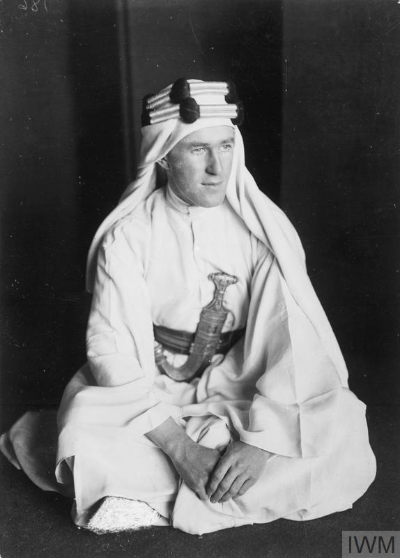 T E LAWRENCE 1888-1935 (Q 73535) Lawrence in Arab dress seated on the ground. Copyright: © IWM. Original Source: http://www.iwm.org.uk/collections/item/object/205022240
