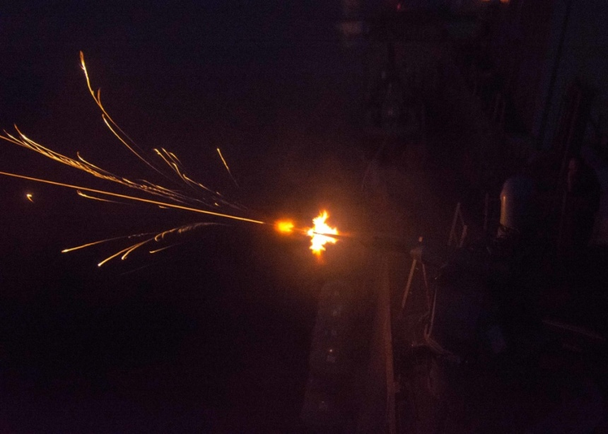 ARABIAN SEA (Sept. 11, 2016) A Mk 38 M242 25mm Bushmaster chain gun fires during nighttime live fire gunnery exercises aboard the guided-missile destroyer USS Mason (DDG 87). Mason, deployed as part of the Eisenhower Carrier Strike Group, is supporting maritime security operations and theater security cooperation efforts in the U.S. 5th Fleet area of operations. (U.S. Navy photo by Mass Communications Specialist 3rd Class Janweb B. Lagazo)
