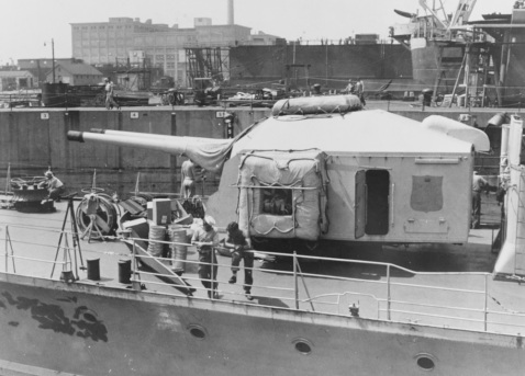 Ex-German Z-39, close up view of the forward 150 mm gun mounting, taken at Boston Navy Yard, 11 August 1945. Note life rafts. Courtesy of Mr. Robert F. Sumrall. Catalog #: NH 75383