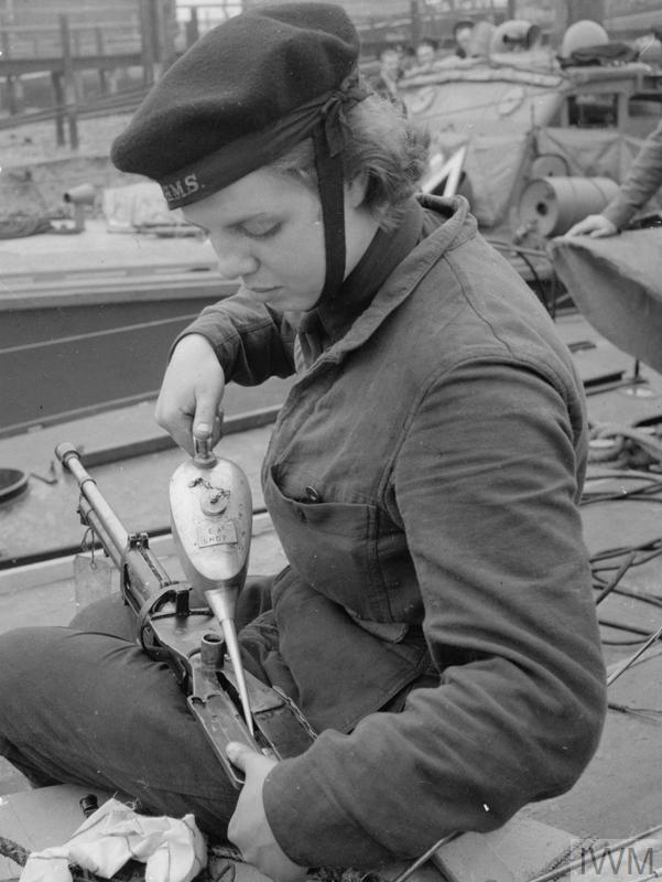 WOMEN'S ROYAL NAVAL SERVICE. MAINTENANCE WRENS MAINTAIN SMALL ARMS UP TO 3 POUNDER HOTCHKISS FOR ALL TYPES OF SMALL CRAFT - MTB, MGB, ML, MOS AND MASB. THESE GIRLS KNOWN AS QO (QUICK-FIRING ORDNANCE) WRENS BOARD THE BOATS AS SOON AS THEY COME IN AFTER AN OPERATION, TO STRIP AND CLEAN THE LEWIS AND 0.5 VICKERS MACHINE GUNS. (A 12189) A QO Wren stripping and cleaning Lewis Guns on board a coastal craft. Copyright: © IWM. Original Source: http://www.iwm.org.uk/collections/item/object/205145634