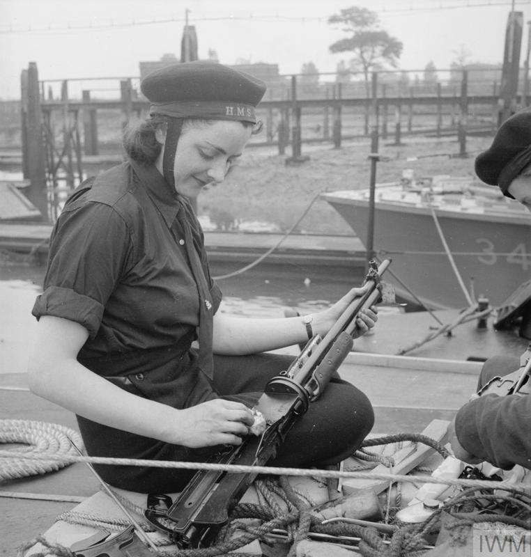 WOMEN'S ROYAL NAVAL SERVICE. MAINTENANCE WRENS MAINTAIN SMALL ARMS UP TO 3 POUNDER HOTCHKISS FOR ALL TYPES OF SMALL CRAFT - MTB, MGB, ML, MOS AND MASB. THESE GIRLS KNOWN AS QO (QUICK-FIRING ORDNANCE) WRENS BOARD THE BOATS AS SOON AS THEY COME IN AFTER AN OPERATION, TO STRIP AND CLEAN THE LEWIS AND 0.5 VICKERS MACHINE GUNS. (A 12193) A QO Wren stripping and cleaning a Lewis Gun on board a coastal craft. Copyright: © IWM. Original Source: http://www.iwm.org.uk/collections/item/object/205145638