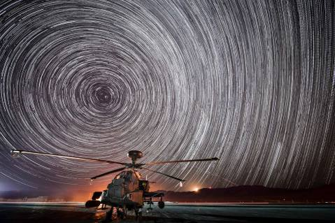 Star trails over an Apache AH Mk 1 of 4 Regiment Army Air Corps (4 Regt AAC) sitting in the Mojave Desert during a Joint Helicopter Command (JHC) training exercise, working alongside Dutch, US and Singapore troops as part of Ex Black Alligator currently taking place in California. MoD photo.