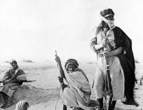 Three Bedouin warriors during the Arab Revolt, 1916-1918. They are armed with 1870s-vintage Martini-Henry rifles, typical of the outdated firearms the British supplied to the Arab forces