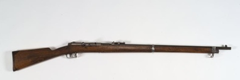 Turkish M1887 Rifle (FIR 7913) The Turkish Model 1887 rifle was the first of a series of rifles produced for the Turkish Army by Mauser of Germany. Its design echoed that of the German Gewehr 71/84 service rifle, being a bolt-action weapon with a tubular magazine beneath the barrel. This particular rife was presented by the Emir Feisal to Captain WHD Boyle, Officer Commanding the Royal Navy Red Sea Squadron, in recognition of a... Copyright: © IWM. Original Source: http://www.iwm.org.uk/collections/item/object/30035040