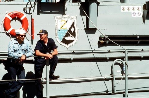 two-sailors-lean-on-a-railing-on-the-starboard-side-of-the-patrol-combatant-missile-hydrofoil-uss-gemini-phm-6