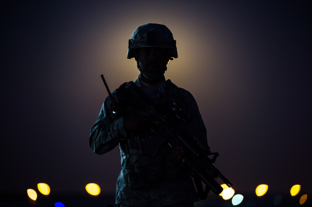 A member of the 380th Air Expeditionary Wing security forces stands on a flight line near a guard tower at an undisclosed location in Southwest Asia, Nov. 14, 2016. Behind the Airman a rare Supermoon rises in the sky. The moon has not been closer to the Earth since Jan. 26, 1948. (U.S. Air Force photo by Senior Airman Tyler Woodward)