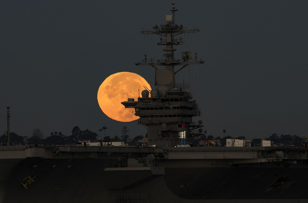 161114-N-PJ969-038  CORONADO, Calif. (Nov. 14, 2016) The brightest moon in almost 69 years sets behind the aircraft carrier USS Theodore Roosevelt (CVN 71). The ship is moored and homeported in San Diego. It is undergoing a scheduled Planned Maintenance Availability. (U.S. Navy photo by Petty Officer 2nd Class Abe McNatt/Released)