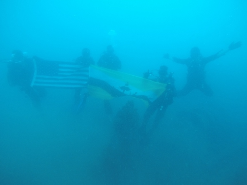 USS SALUTE (November 16, 2016) U.S. Navy Divers attached to Mobile Diving & Salvage Company ONE divers serving with the Royal Brunei Armed Forces gather for a group photo at the wreckage site of USS Salute (AM-294), which sank in Brunei waters on June 7, 1945, during Cooperation Afloat Readiness and Training (CARAT) Brunei 2016, Nov. 15. CARAT is a series of annual maritime exercises between the U.S. Navy, U.S. Marine Corps and the armed forces of nine partner nations to include Bangladesh, Brunei, Cambodia, Indonesia, Malaysia, the Philippines, Singapore, Thailand, and Timor-Leste. (U.S. Navy photo by Lt. Chris Price/RELEASED)