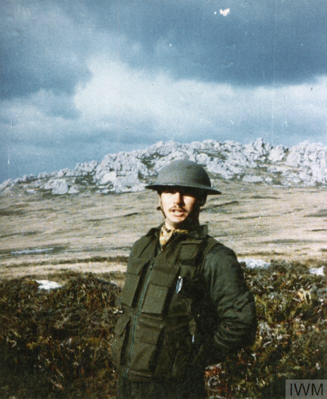 THE FALKLANDS CONFLICT, APRIL - JUNE 1982 (FKD 2935) Argentine snapshot showing an Argentine soldier from Batallon de Infanteria Marina 5 (5 BIM) on Mount Tumbledown during the Argentine occupation of the Falkland Islands. The soldier is wearing a British Second World War style helmet (probably looted as a souvenir from the Falkland Islands Defence Force (FIDF) stores in Port Stanley) and is carrying a Ballestos Molina pistol under his left arm. Thi... Copyright: � IWM. Original Source: http://www.iwm.org.uk/collections/item/object/205018702