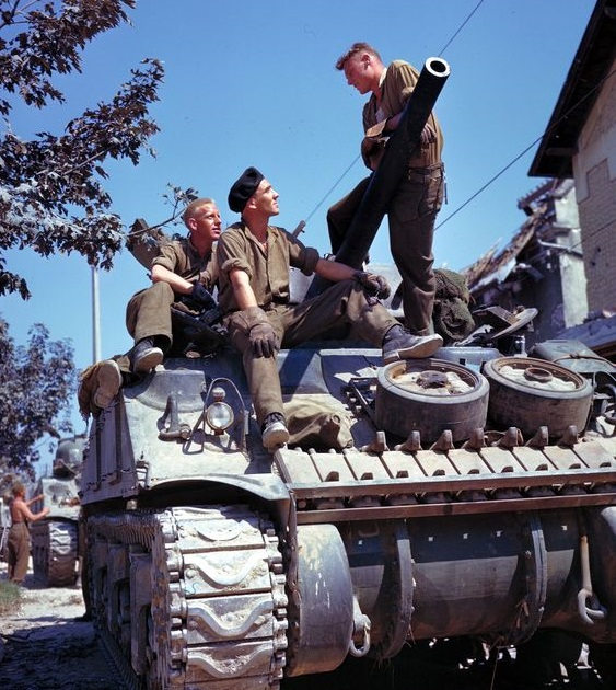 A rare colorchrome of a Sherman V of the Canadian 29th Reconnaissance regiment (The South Alberta Regiment). The Tank was commanded by Major David Currie (VC), and the tank was named 'Clanky'. This photo was taken in Normandy around Arromanches in July of 1944. Photo via TheShermanTank.com http://www.theshermantank.com/category/allied-use-wwii/