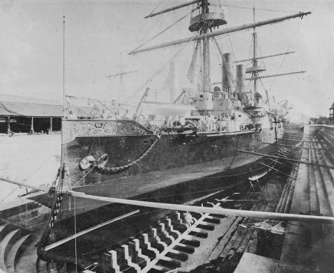 In drydock at the New York Navy Yard, Brooklyn, New York, 1888. Note fancy scrollwork on her bow bulwark, and reinforcing strip on the side of her ram bow. U.S. Naval History and Heritage Command Photograph. Catalog #: NH 56526