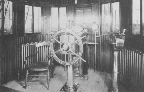 View in ship's chart house, 1888, showing steering wheel, binnacle, engine order telegraph, steam radiators, and other features. U.S. Naval History and Heritage Command Photograph. Catalog #: NH 56540