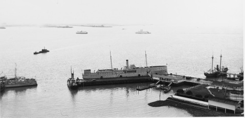 USS Boston tied up at Yerba Buena Island, while serving as receiving ship there, shortly before World War II. This ship was renamed Despatch on 9 August 1940 and designated IX-2 on 17 February 1941. Note the old destroyers at left, lightship at right and San Francisco Bay ferryboats in the distance. Courtesy of Ted Stone, 1979. U.S. Naval History and Heritage Command Photograph. Catalog #: NH 89404