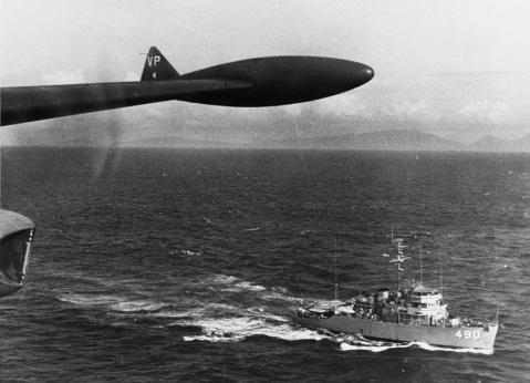 USS LEADER (MSO-490) Caption: Is seen from a Saigon based SP-2H Neptune aircraft while on a Market Time patrol during the later 1960s. The plane and ship are exchanging information on coastal traffic in the area. Description: Catalog #: NH 92011
