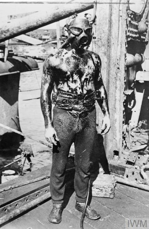 An oil covered US Navy diver after working on one of the sunken ships, Pearl Harbor, Hawaii, 7th December 1941.