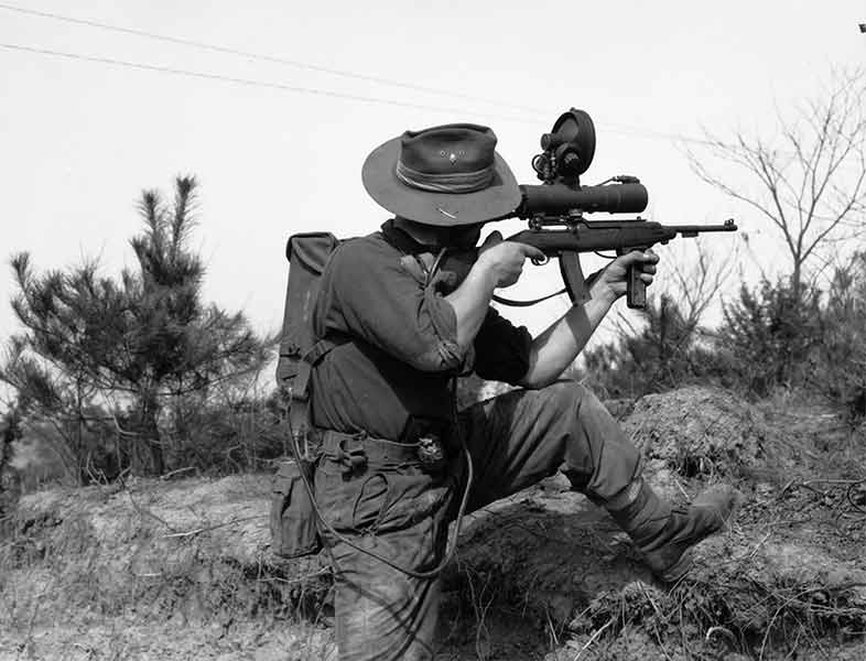 Australian soldier takes aim with his M3 Carbine during the Korean war. Note the extensive infrared spotting system