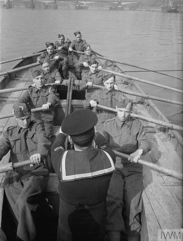 """""""Boat pulling"""" part of their elementary training. Many of the Maritime Royal Artillery have been torpedoed and have had to take to open boats. Training in the whaler makes them useful members of a boat's crew. Copyright: © IWM. Original Source: http://www.iwm.org.uk/collections/item/object/205149662"""