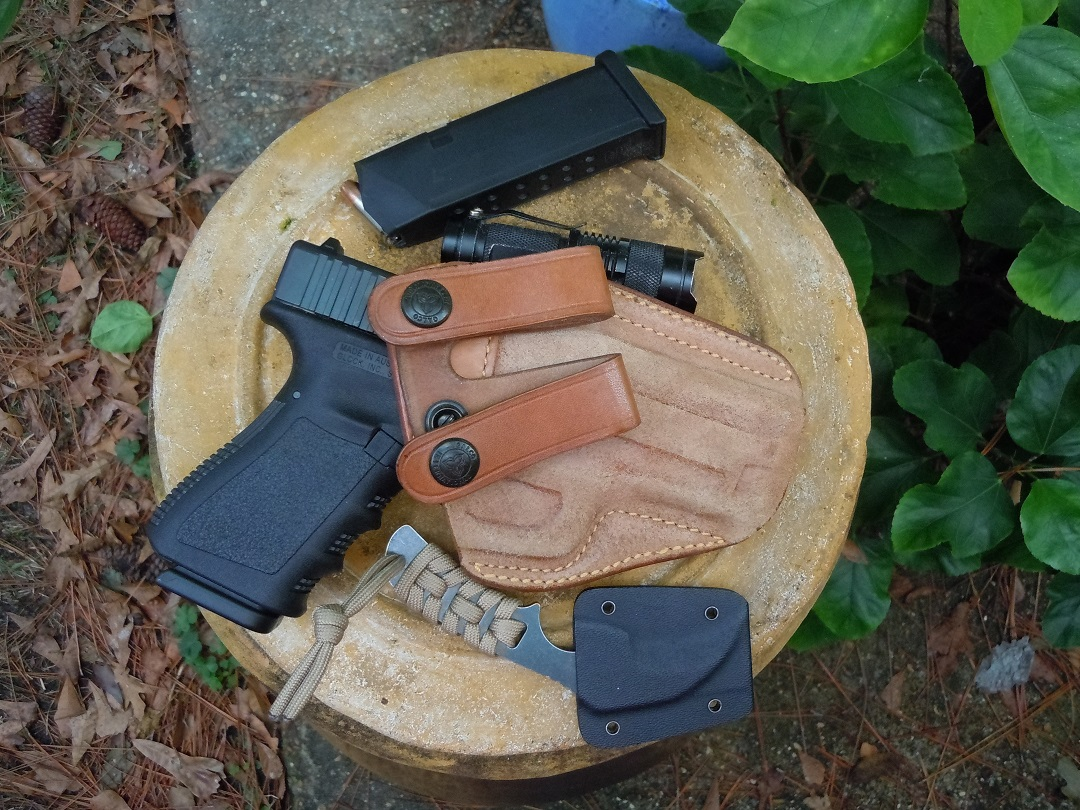 """My current """"winter"""" EDC: Gen 3 Glock 19 in Galco Royal Guard inside the waistband holster, cheapo Cree LED light (they work well, are adjustable and are inexpensive if you lose them), Skallywag Gladium knife, extra mag."""