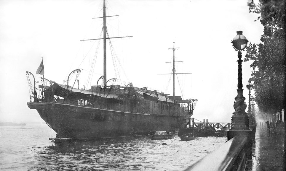 HMS President moored on the Thames at high tide in 1929. Photograph Planet News Archive.