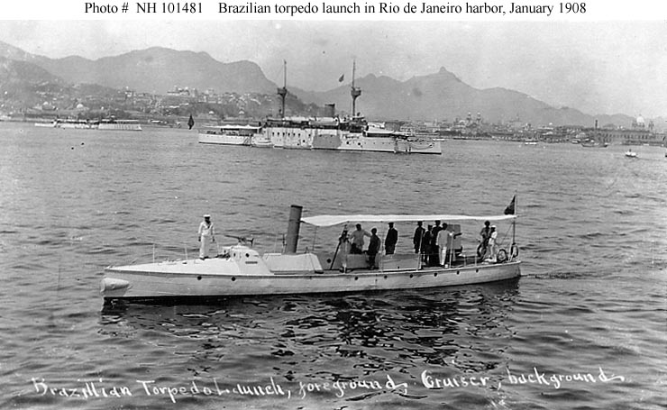 Brazilian Torpedo Launch. In Rio de Janeiro harbor, Brazil, during the U.S. Atlantic Fleet's visit there while en route to the Pacific, circa 12-22 January 1908. The Brazilian cruiser in the center distance is either Marshal Deodoro or Marshal Floriano. The torpedo gunboat in the left distance is a member of the Brazilian Tupy class. Collection of Chief Quartermaster John Harold. U.S. Naval History and Heritage Command Photograph. Photo #: NH 101481
