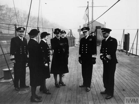 THE DUCHESS OF KENT VISITS HMS PRESIDENT. 15 MARCH 1943, WEARING THE UNIFORM OF COMMANDANT OF THE WRNS, THE DUCHESS OF KENT PAID AN INFORMAL VISIT TO HMS PRESIDENT. (A 15047) On extreme left is Captain R D Binney, CBE, RN, The Duchess of Kent, Admiral Sir Martin R Dunbar Nasmith, and Commander H C C Clarke, DSO, RN. Copyright: © IWM. Original Source: http://www.iwm.org.uk/collections/item/object/205148173