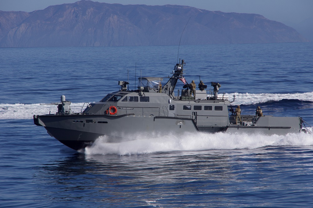 161104-N-ZC343-293 PACIFIC OCEAN (Nov. 4, 2016) A U.S. Navy Mark VI patrol boat wards off a simulated attacker during show of force strait transit exercise involving aircraft carrier USS Carl Vinson and Carrier Strike Group 1. (U.S. Navy photo by Senior Chief Petty Officer Joe Kane/Released)
