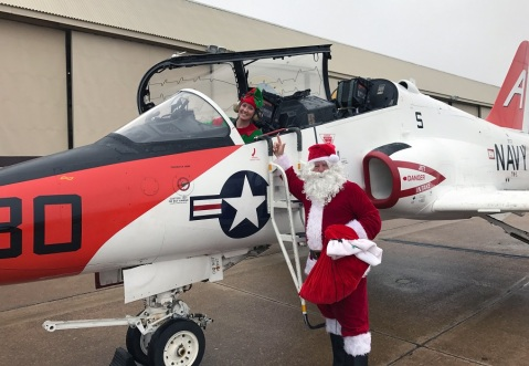 MERIDIAN, Miss. (Dec. 4, 2016) Santa Claus and an elf get out of a T-45C Goshawk during a visit to Training Air Wing One for a children's Christmas party. (U.S. Navy photo by Cmdr. Damon Slutz/Released) 161204-N-N0101-001