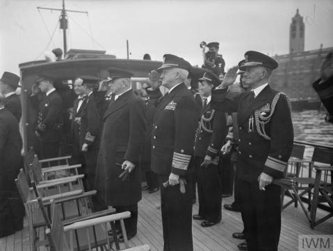 ADMIRAL'S FAREWELL DINNER TO ADMIRAL STARK AT GREENWICH. 13 AUGUST 1945, ROYAL NAVAL COLLEGE, GREENWICH, DURING THE FAREWELL DINNER TO ADMIRAL H R STARK, USN, BY THE BOARD OF ADMIRALTY. (A 30003) Saluting HMS PRESIDENT en route to Greenwich, left to right: Mr A V Alexander; Admiral Stark; and Rear Admiral C B Barry, DSO, Naval Secretary. Other members of the party including Mr G H Hall can also be seen. Copyright: © IWM. Original Source: http://www.iwm.org.uk/collections/item/object/205161196